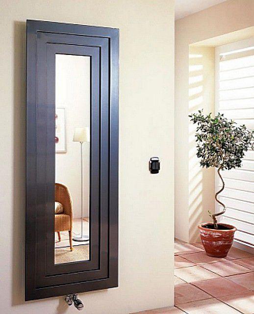 Это не просто зеркало в аккуратной рамке – таким может быть вертикальный радиатор отопления