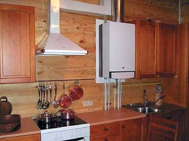 Настенный двухконтурный газовый котелотлично впишется в кухонный интерьер