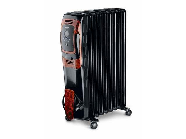 Один из самых распространенных  обогревательных приборов - масляный радиатор